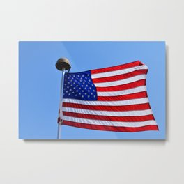 United States flag waving with a military helmet on the mast Metal Print