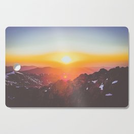 pink and orange sunrise over the mountains Cutting Board
