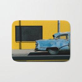 Rusty Blue Car and Yellow Wall Bath Mat
