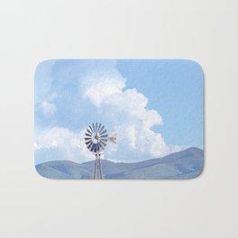 """Blue Windmill Blue Sky"" by Murray Bolesta Bath Mat"