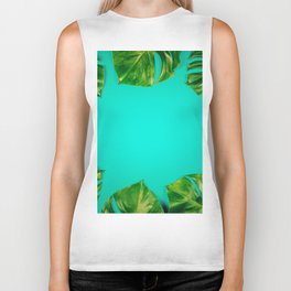 Tropical leaves Monstera on colorful background, close up Biker Tank