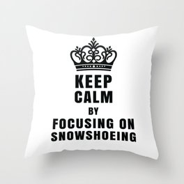 KEEP CALM BY FOCUSING ON SNOWSHOEING Throw Pillow