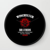 winchester Wall Clocks featuring Winchester Brothers by YiannisTees