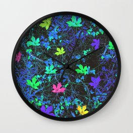 maple leaf in pink green purple blue yellow with blue creepers plants background Wall Clock