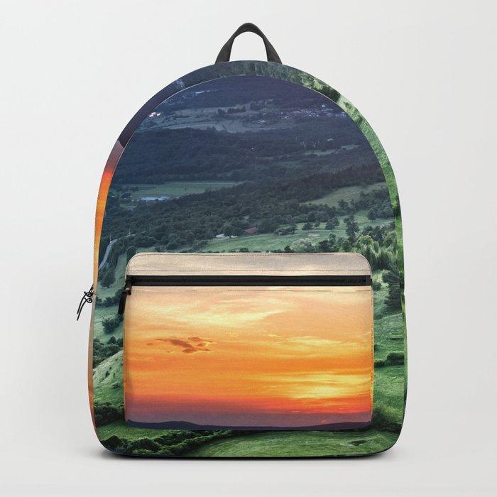 Beautiful sunset behind green fields Backpack