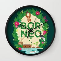 indonesia Wall Clocks featuring Borneo Indonesia by swanderfulthings