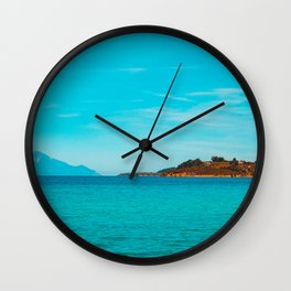 Some mountains in the sea Wall Clock