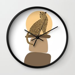 Leopard on the rocks Wall Clock