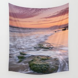 Green rocks. Sunset at the beach Wall Tapestry