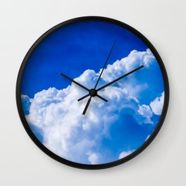 White clouds in the blue sky Wall Clock