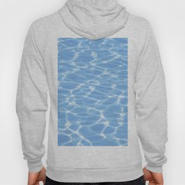 Blue ripped water in swimming pool background Hoody
