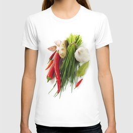A bunch of fresh chives and vegetables over white T-shirt