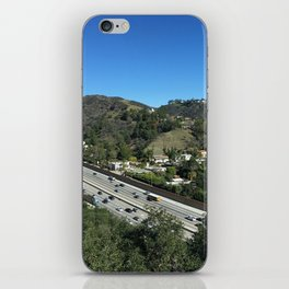 City in mountains, highway passing through iPhone Skin