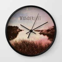 wanderlust Wall Clocks featuring Wanderlust by Brianne Lanigan