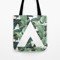 banana leaf Tote Bags featuring Banana Leaf Love by Emily Wagner Studio