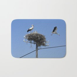A storks' nest on a telegraph pole Bath Mat