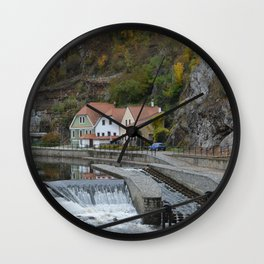 Colorful houses near a river Wall Clock