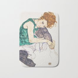 Girl sitting with knees up by Egon Schiele Bath Mat