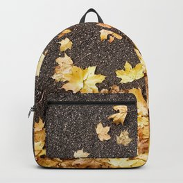Gold yellow maple leaves autumn asphalt road Backpack