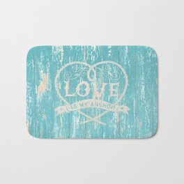 Maritime Design - Love is my anchor on teal grunge wood background Bath Mat