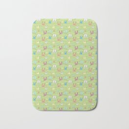 Colorful bunnies on green background Bath Mat