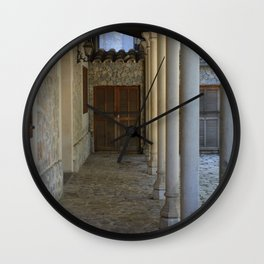 Gallery with pillars and old doors Wall Clock