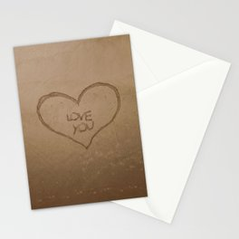 'Love you' text written on a sandy beach Stationery Cards
