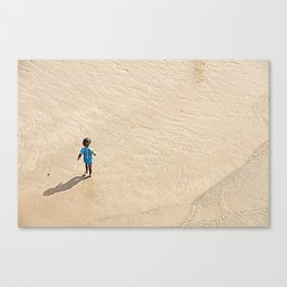 Child at the beach Canvas Print
