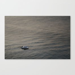 Small boat anchored in the river Canvas Print
