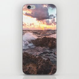 Seascape at sunset in a rocky beach iPhone Skin