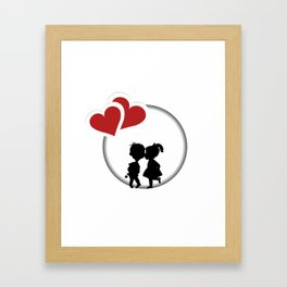 Round frame with silhouette of a boy and a girl kissing and two hearts Framed Art Print