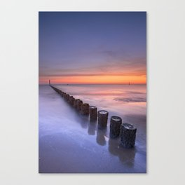 Breakwater on the beach at sunset in Zeeland, The Netherlands Canvas Print