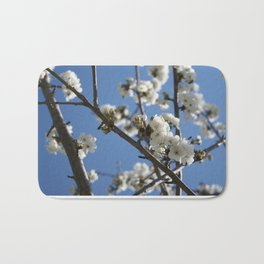 Cherry Blossom Branches Against Blue Sky Bath Mat