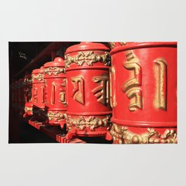 Red prayer drums row Rug