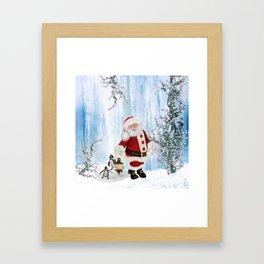 Santa Claus with funny penguin Framed Art Print