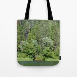 one kayak in the green Tote Bag