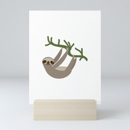cute Three-toed sloth on green branch Mini Art Print