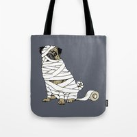 return Tote Bags featuring The Mummy Pug Return by Huebucket