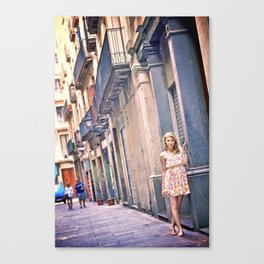 Blonde girl near an old building in Barcelona Canvas Print
