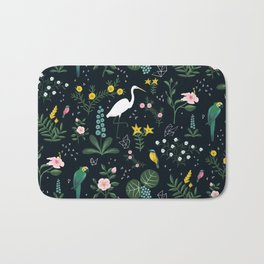 """""""Tropical Birds and Flowers"""" on Midnight Blue by Bex Morley Bath Mat"""