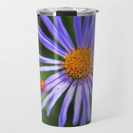 The runway of a ladybird Travel Mug