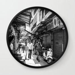 People walking in a street in Old Delhi, India Wall Clock