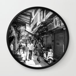 People walking in a street in Old Delhi, India Wall Clock