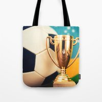 world cup Tote Bags featuring world cup trophy by franckreporter