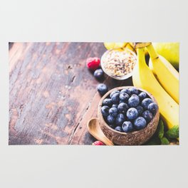 Close-up of fresh fruits and seeds in wooden tray Rug