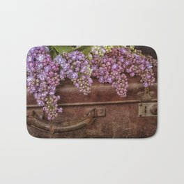Vacation in the spring- lilac and vintage suitcase Bath Mat