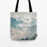 bible verses Tote Bags featuring Typographic Motivational Bible Verses - Psalm 46:1 by The Wooden Tree