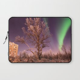 Green northern lights with tree in the middle over the Kiruna town in Sweden. Laptop Sleeve