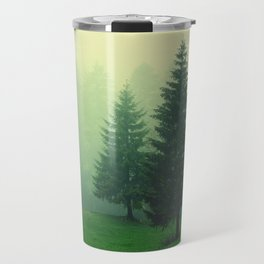 Beautiful green forest with tall trees in a foggy weather Travel Mug