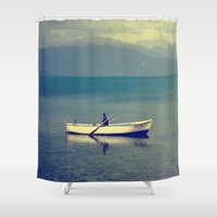 rowing Shower Curtains featuring rowing a boat in egirdir lake by gzm_guvenc